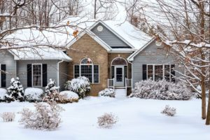 Beautiful home and lawn covered in snow